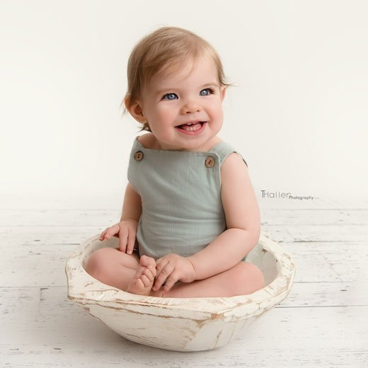 Newborn, Baby, Maternity Photography North Vancouver - Baby boy sitting in a white wood bowl and smiling