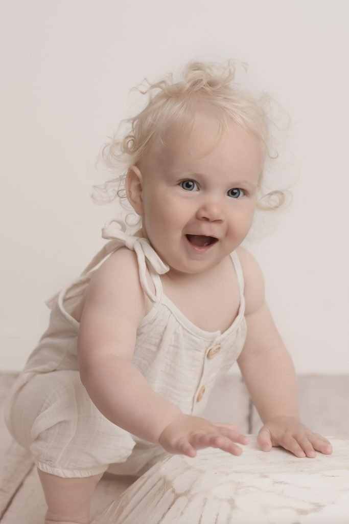 Baby, Milestone Photographer North Vancouver - Happy Baby Girl wearing a beige romper
