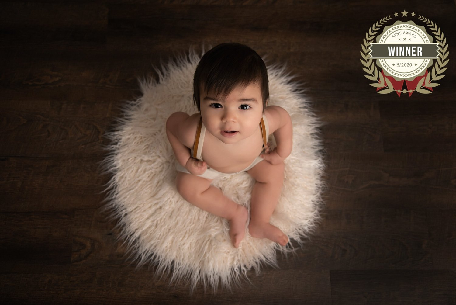 Baby, Milestone Photographer North Vancouver - Baby Boy sitting on a white float rug and looking up into the camera