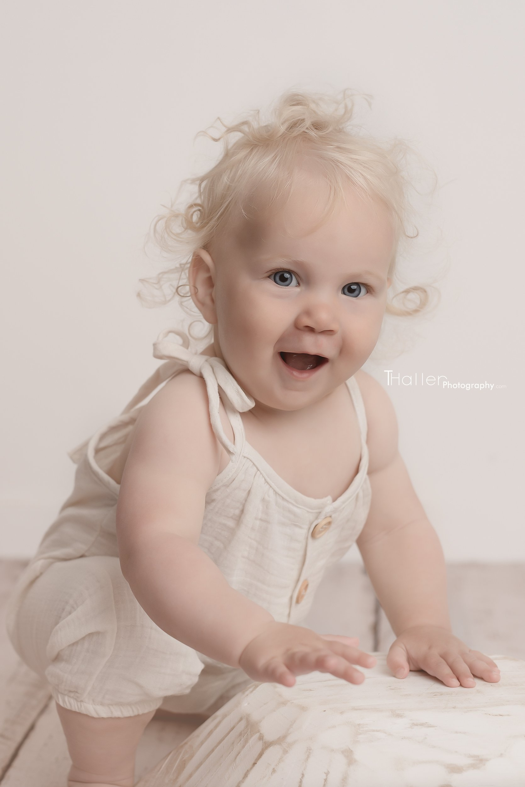 Baby, Milestone Photographer North Vancouver - Baby Girl with blond curls sitting and smiling