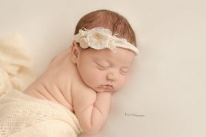 sleeping baby girl wearing a flower headband