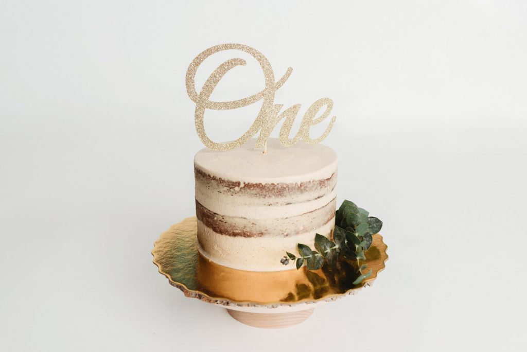 North Vancouver Newborn Photographer - Cake for cake smash with a gold one as topper