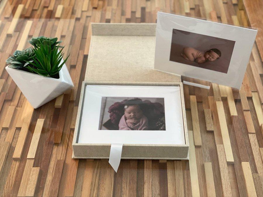 Folio Album in oatmeal colour with example folios of a newborn girl photo shoot