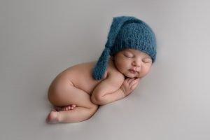 Vancouver Newborn Photo baby boy wearing blue hat