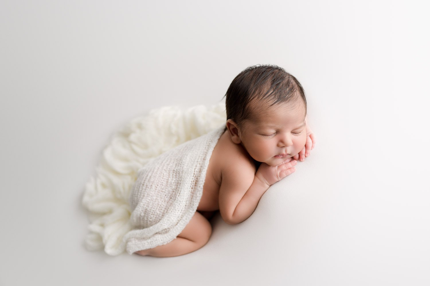 North Vancouver Newborn Boy sleeping draped in a white blanket